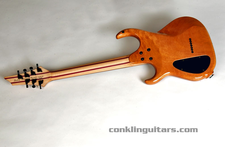 The back of the guitar features a one-piece Mahogany body