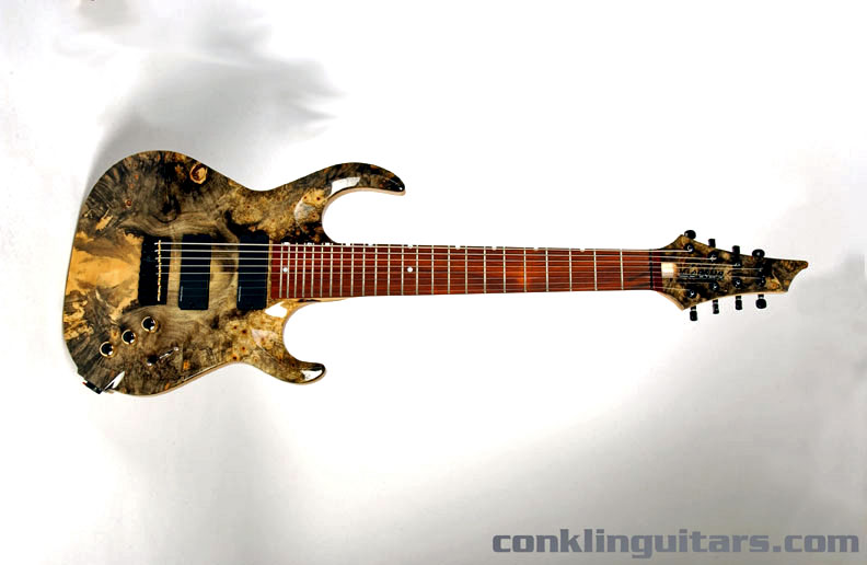 An extraordinary bookmatched Buckeye Burl top and matching headstock cap provide an awe-inspiring aesthetic like no other
